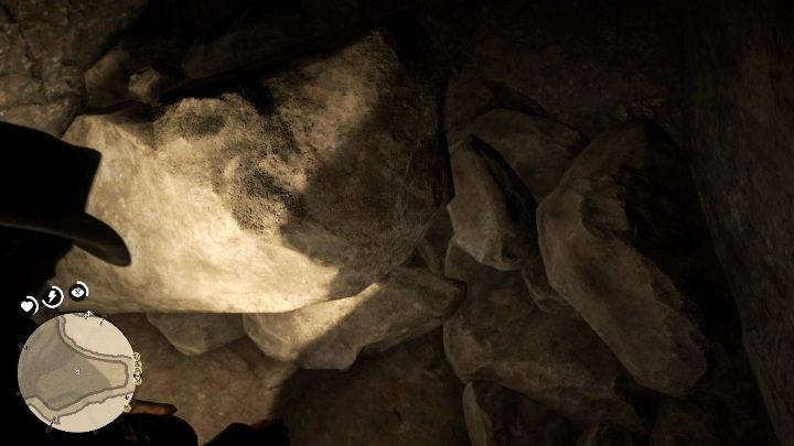 Keep following the stone ledge - The Poisonous Trail Treasure Hunt in Red Dead Redemption 2 - Secrets and collectibles - Red Dead Redemption 2 Guide