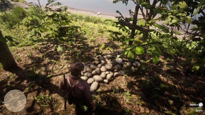 The grave is in the grass, near the river - Graves in Red Dead Redemption 2 - Secrets and collectibles - Red Dead Redemption 2 Guide