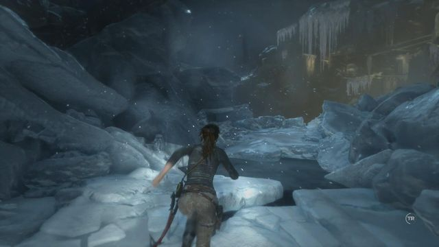 Once you exit the water, the chopper is still firing at you - Survive the freezing waters | Fugitive - Fugitive - Rise of the Tomb Raider Game Guide & Walkthrough