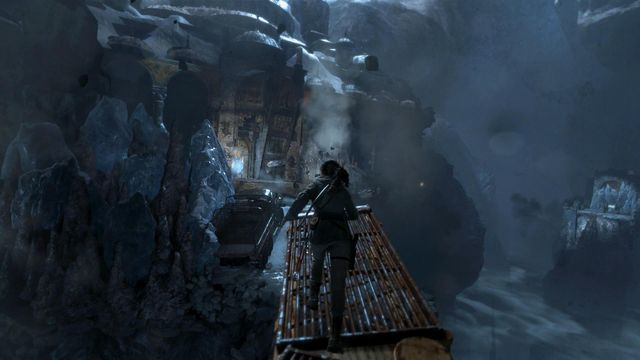 Over the slanting crane, run towards the gate quickly and take a leap, at the end that saves Laras life - Break through the door | Shortcut - Shortcut - Rise of the Tomb Raider Game Guide & Walkthrough