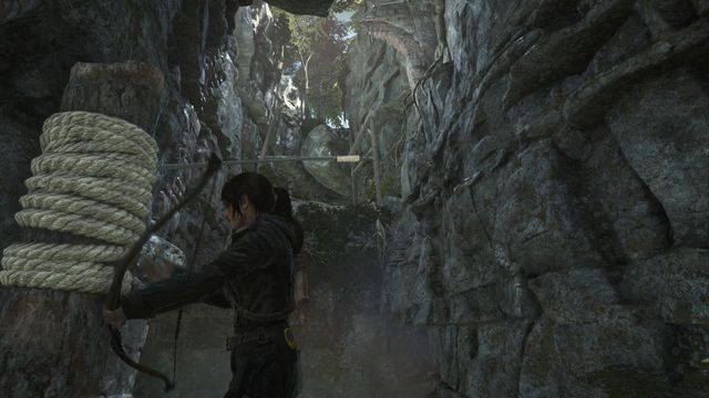 Shoot an arrow towards the rope bundle in the distance - Find a way into the Acropolis | Into the Acropolis - Into the Acropolis - Rise of the Tomb Raider Game Guide & Walkthrough