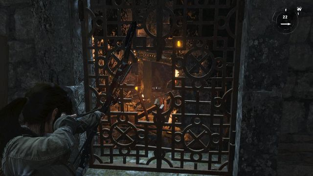 After you collect the projectiles, get back through the window with grate and aim at the blockade in front of the door - Destroy the blockade to free the Remnants | To the Tower - To the Tower - Rise of the Tomb Raider Game Guide & Walkthrough