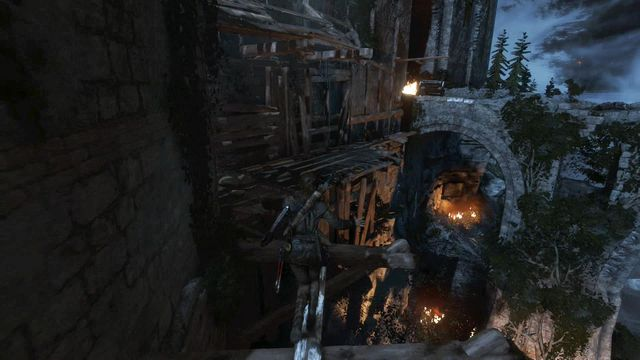Walk over the plank towards the collapsed bridge - Breach the gate to the Tower Courtyard | To the Tower - To the Tower - Rise of the Tomb Raider Game Guide & Walkthrough