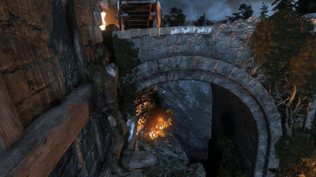 There is a bottleneck past the footbridge - Breach the gate to the Tower Courtyard | To the Tower - To the Tower - Rise of the Tomb Raider Game Guide & Walkthrough