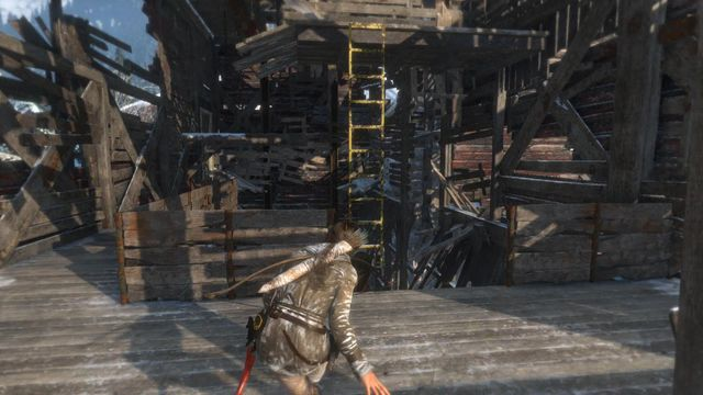 After you kill the guard, jump onto the yellow ladder and climb up to reach the next level of the mill - Climb the copper mill to reach the mine entrance | Alone Again - Alone Again - Rise of the Tomb Raider Game Guide & Walkthrough