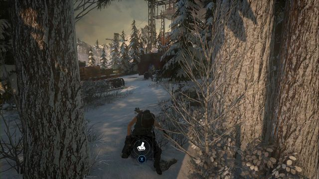 In the forest, past the skating rink, close to the vehicles at the edge, at the tree - Survival Caches | Research Base - Research Base - Rise of the Tomb Raider Game Guide & Walkthrough