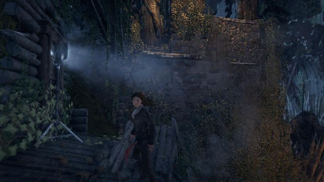 At the end of the village, from the building guarded by mercenaries, you can make it over to the other side of the wall - Scale the Cathedral to find the entrance | Silent Night - Silent Night - Rise of the Tomb Raider Game Guide & Walkthrough