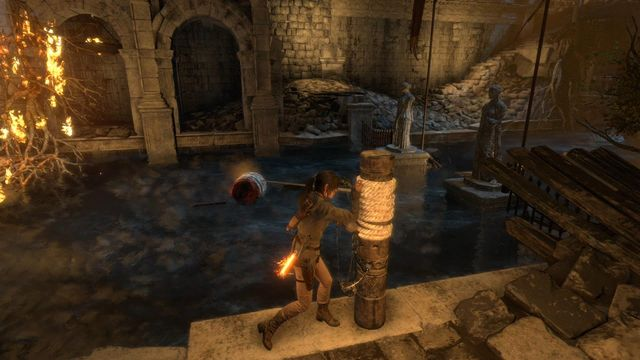 Quickly, follow the water current for several steps and stand next to the pole wound in rope - Find a way to escape with the Atlas | Rising Tide - Rising Tide - Rise of the Tomb Raider Game Guide & Walkthrough
