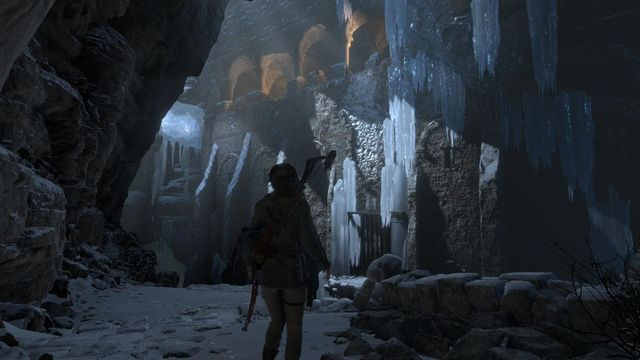 Jump over onto the walls, and use the hatchet to climb towards the edge - Find a way into the heart of Kitezh | Through the Glacier - Through the Glacier - Rise of the Tomb Raider Game Guide & Walkthrough