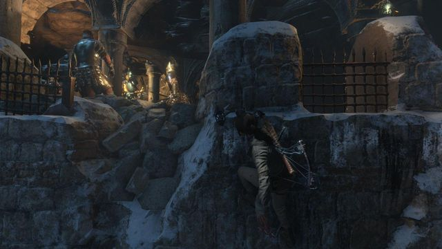 Move along the upper edge of the wall and keep an eye on the Deathless preparations for battle - Find a way into the heart of Kitezh | Through the Glacier - Through the Glacier - Rise of the Tomb Raider Game Guide & Walkthrough