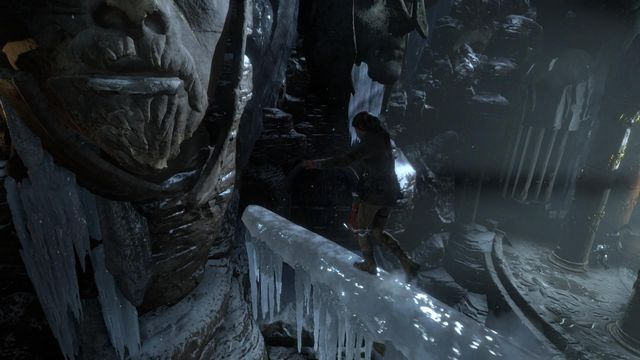 Jump over onto the lips of the huge head, from the beam covered with ice - Find a way into the heart of Kitezh | Through the Glacier - Through the Glacier - Rise of the Tomb Raider Game Guide & Walkthrough