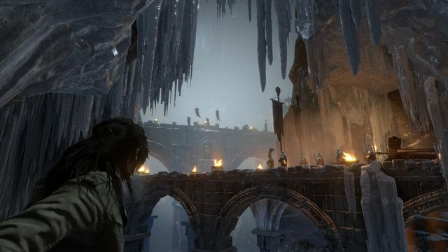 Past the camp, Lara will have to walk over a narrow ledge, while hugging the wall - Find a way into the heart of Kitezh | Through the Glacier - Through the Glacier - Rise of the Tomb Raider Game Guide & Walkthrough
