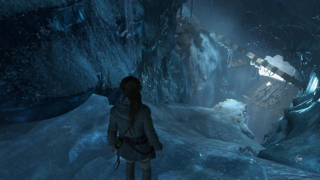 Slide down the patch of ice and, at the right moment, take a leap using hook and rope to make it over to safety - Find a way into the lost city of Kitezh | Breaking In - Breaking In - Rise of the Tomb Raider Game Guide & Walkthrough