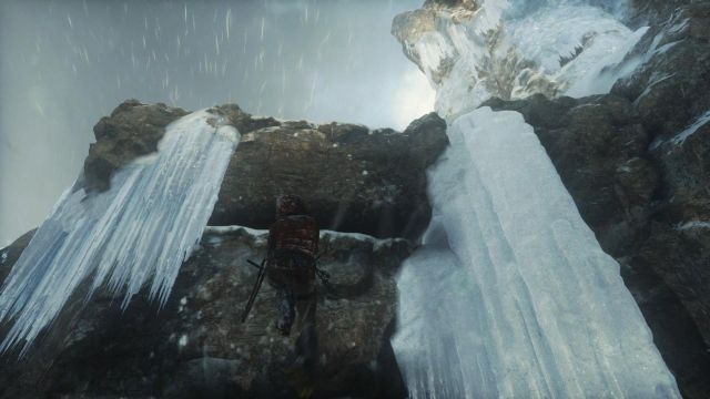 Lara will manage to stick the axe into the ice with enough strength to hold her - Get to the top of the mountain | Siberian Wilderness - Passageway - Siberian Wilderness - Passageway - Rise of the Tomb Raider Game Guide & Walkthrough