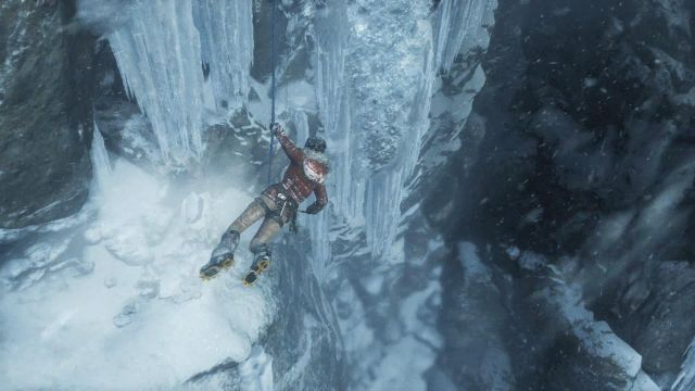 Lara is hanging on the rope - Get to the top of the mountain | Siberian Wilderness - Passageway - Siberian Wilderness - Passageway - Rise of the Tomb Raider Game Guide & Walkthrough