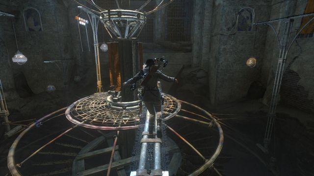Jump onto the balance beam and run towards the base grate of the device - Use the planetarium to open the entrance to Kitezh | Path of the Deathless - Path of the Deathless - Rise of the Tomb Raider Game Guide & Walkthrough