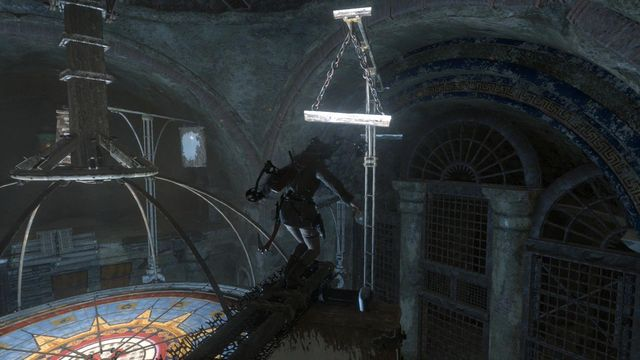 While on the turning beam, you need to jump over towards the beam hanging on chains - Use the planetarium to open the entrance to Kitezh | Path of the Deathless - Path of the Deathless - Rise of the Tomb Raider Game Guide & Walkthrough