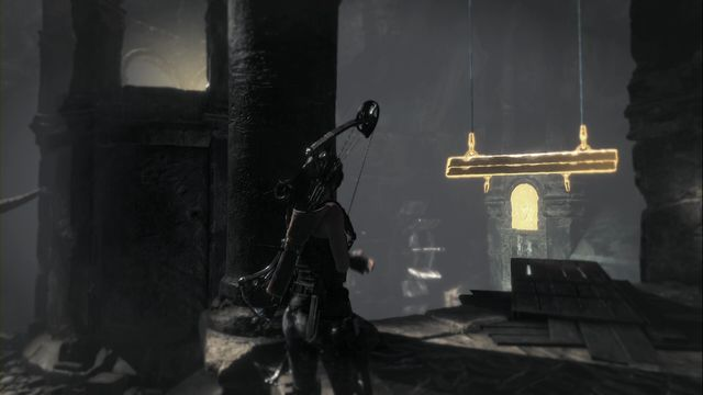 Lower the water level by grabbing on to the beam. - Tomb - Ancient Cistern [3/9] | Soviet Installation - Soviet Installation - Rise of the Tomb Raider Game Guide & Walkthrough