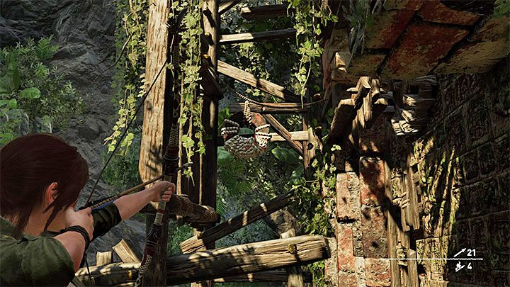 Examine the damaged, outer part of the tower and you will find the round lever shown on the picture - How to complete the Trial of the Eagle in Shadow of the Tomb Raider Game? - Solving Riddles - Shadow of the Tomb Raider Game Guide