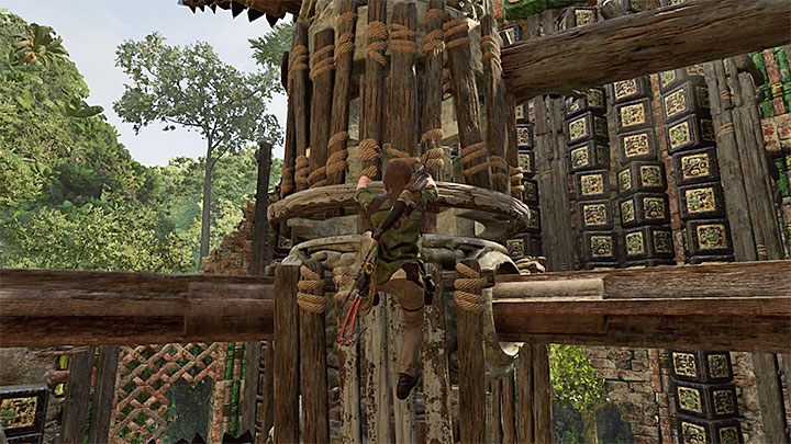 Just as before, you have to wait for the right moment for reaching one of the ladders mounted onto the central mechanism - How to complete the Trial of the Eagle in Shadow of the Tomb Raider Game? - Solving Riddles - Shadow of the Tomb Raider Game Guide