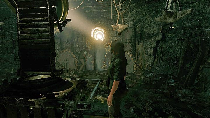 Move the cart towards the hole in the ceiling, the one through which the light comes in - How to solve the way of the cross puzzle beneath the library in San Juan? - Solving Riddles - Shadow of the Tomb Raider Game Guide