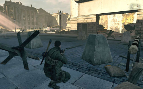 In the left corner of the square, right behind a concrete pillar beside the fenced passage [#6] - Mission 4 - Wine Bottles and Gold Bars - Sniper Elite V2 - Game Guide and Walkthrough