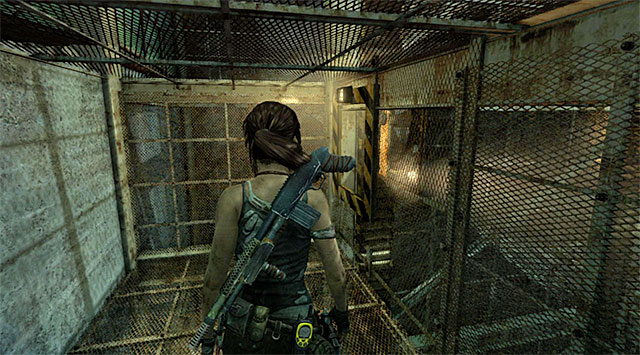 Once you find yourself in very narrow passage, approach the second of four mechanisms and use the axe on it, same as previously - Discover the Ancient Tomb - 23: Storm Chaser - Tomb Raider - Game Guide and Walkthrough