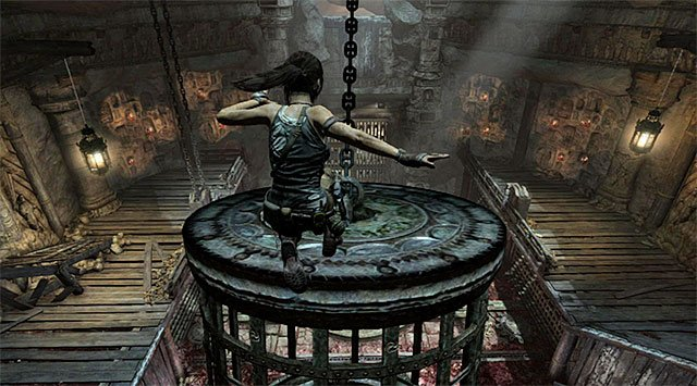 Be ready to action, because when the cage approaches the balcony occupied by you, you'll have to make a jump towards it to safely land on the cage - Rescue Sam from Mathias (part 1) - 24: Going Back In - Tomb Raider - Game Guide and Walkthrough