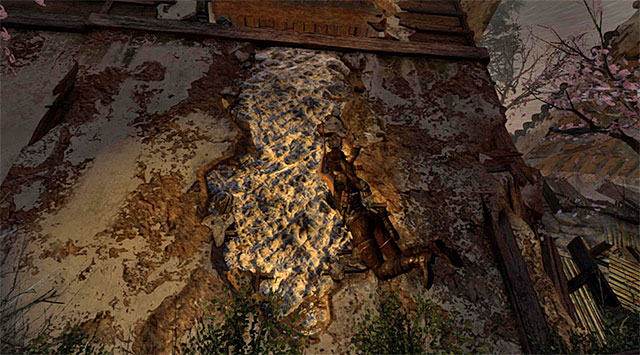 Make your way to the area around the searchlight; youre going to have to scramble up the wall using the climbing axe - Fight Your Way Out of the Palace | 17: Into the Fire Walkthrough - 17: Into the Fire | Walkthrough - Tomb Raider Game Guide