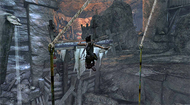 Quickly turn left and perform another jump, this time in order to grab onto an interactive ledge - Well of Tears | Optional Tombs: Shantytown - Shantytown | Optional Tombs - Tomb Raider Game Guide