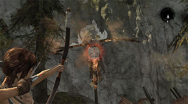 Once the fire burns most of it, shoot a rope arrow at the indicated spot to destroy the effigy altogether (reward: 10 XP) - Laid to Rest | Collectibles: Shantytown - Collectibles: Shantytown - Tomb Raider Game Guide