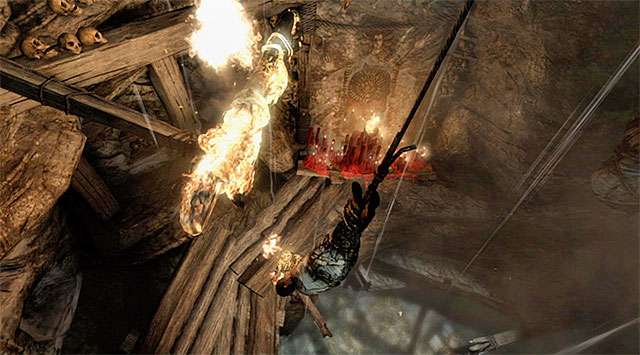 Swing the cocoon once again to get close to the flames on the left - Keep Moving Forward to Survive | 1: Survive Walkthrough - 1: Survive | Walkthrough - Tomb Raider Game Guide
