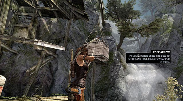 In order to unlock a way into the next location, shoot a rope arrow at the crate hanging from a hoist - Regroup with Roth | 9: A Road Less Traveled Walkthrough - 9: A Road Less Traveled | Walkthrough - Tomb Raider Game Guide