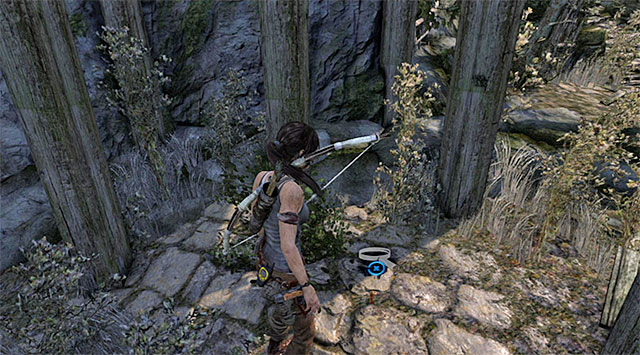 When she lands, go down the stairs and search the area under the hut - GPS Caches (08-15) | Collectibles: Mountain Village - Collectibles: Mountain Village - Tomb Raider Game Guide