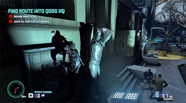 Wait for the first guard to pass you by from the right and walk, carefully under the first camera by keeping to the wall of the building on the left - Find route into Quods HQ - Mission 6 - Special Missions HQ - Tom Clancys Splinter Cell: Blacklist - Game Guide and Walkthrough