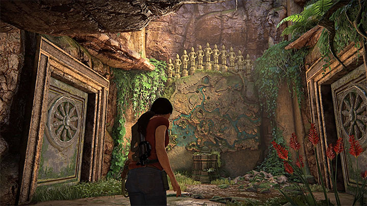Enter the ruins and investigate a large stone map with eleven figurines shown on the screenshot above - 4- Hoysalas Tokens and the Queens Ruby | Walkthrough - Walkthrough - Uncharted: The Lost Legacy Game Guide